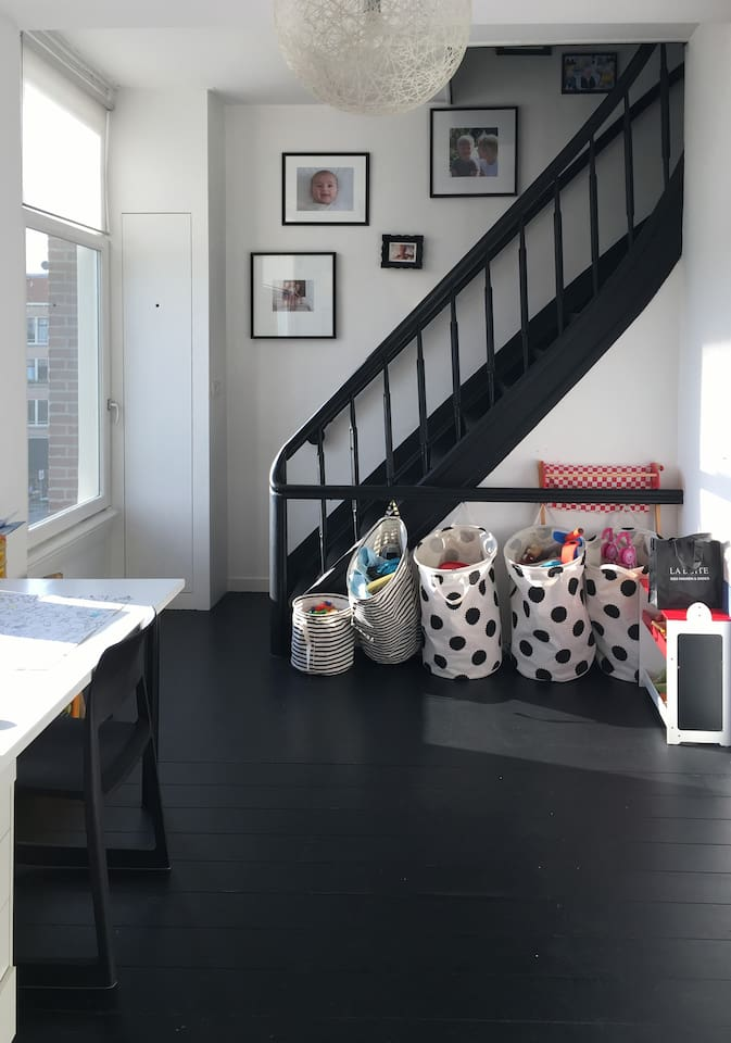 The children's playroom which doubles as a work space.
