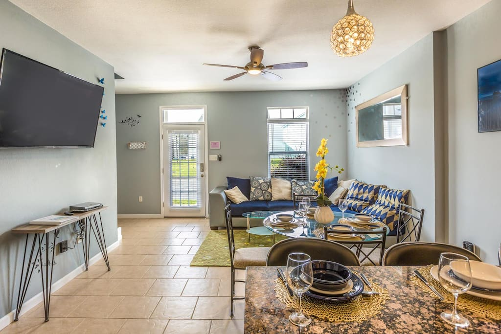Open living area with ceiling fan, large 55 inch smart TV free Netflix, Amazon movies