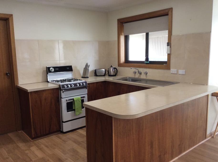 Fully functioning kitchen with full compliment of pots pans crockery and cutlery.