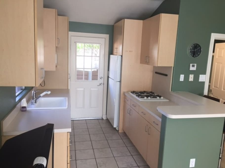 Fully equipped clean open kitchen.