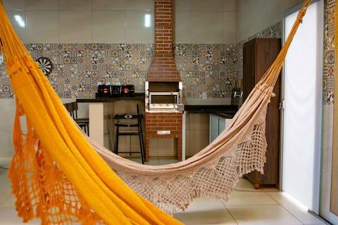 Casa com varanda gourmet recreativa