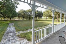 Front porch facing live oaks