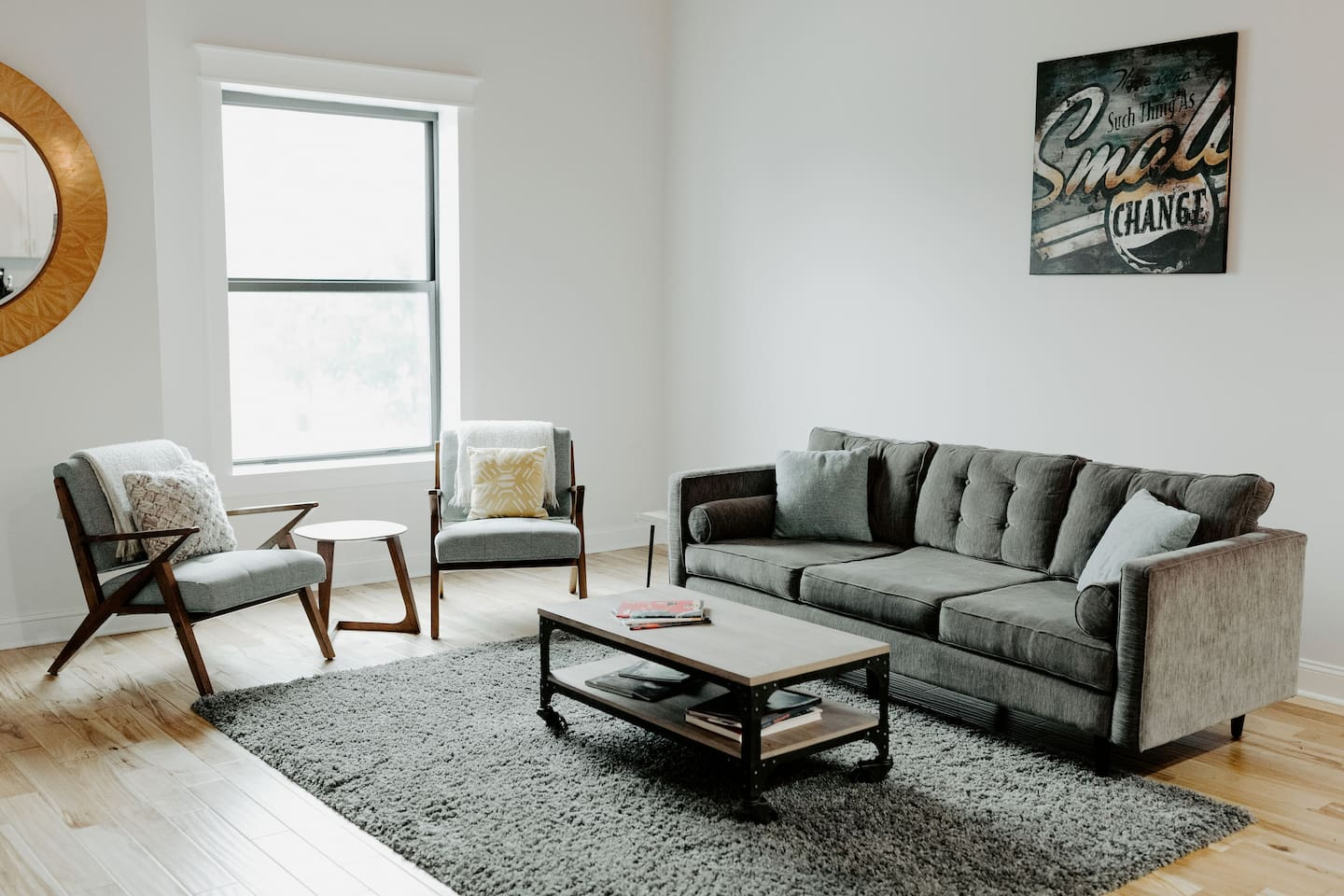 Bright and welcoming living room with large windows and a view of the city and Lucas Oil Stadium