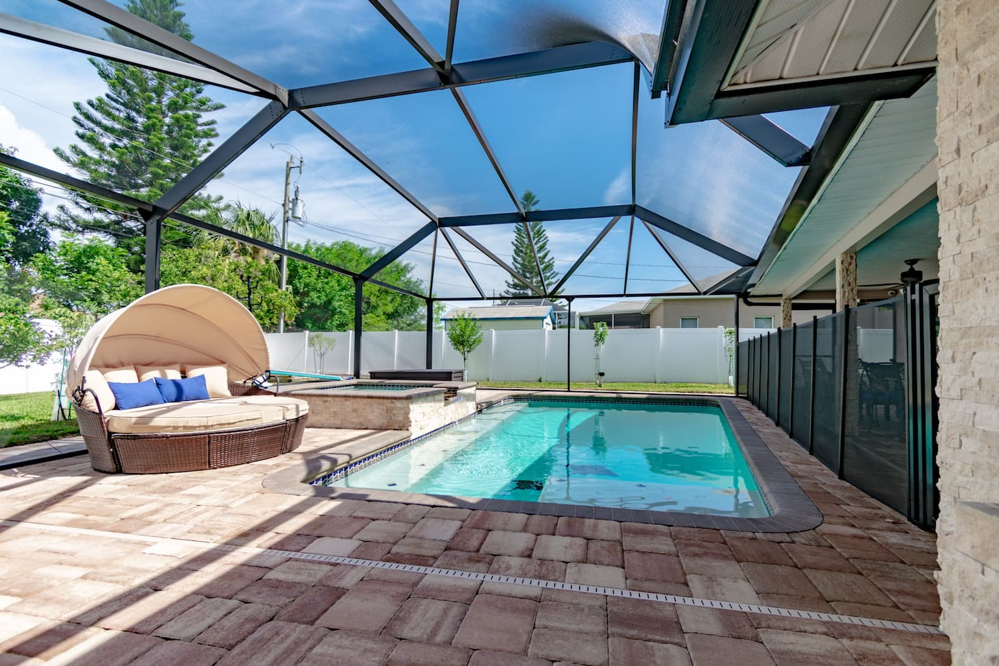 pool with spa and cabana for two. Child proof gating can be removed from pool to open to barbecue and seating.