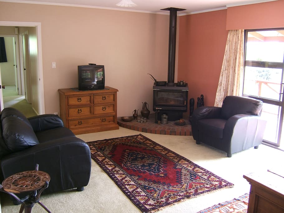 Lounge area with TV and video recorder opening onto the balcony area