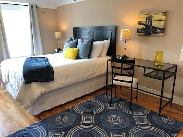Master Suite with sound machine, room darkening curtains, roller shade, and desk