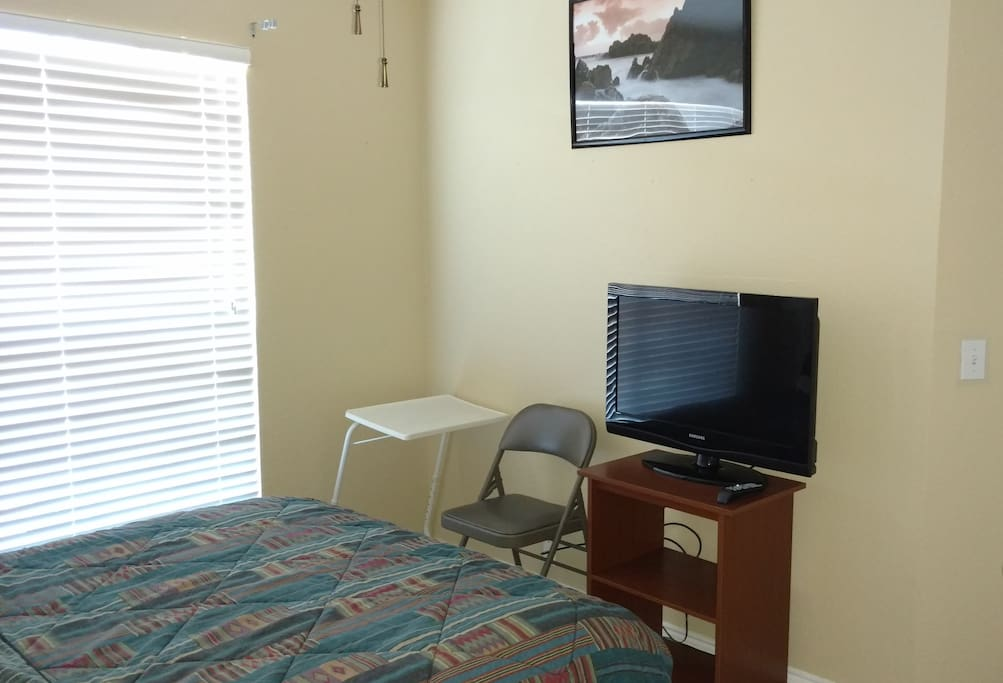 TV, Desk and Chair in the Room