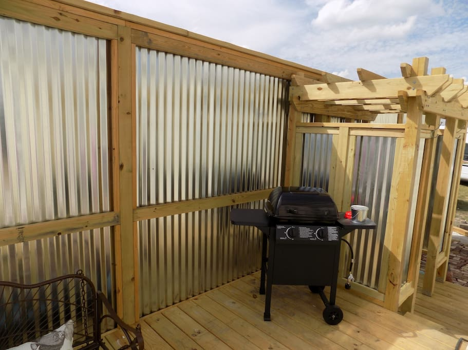 Porch with BBQ and outdoor shower