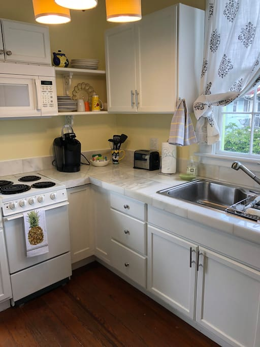 Small but complete kitchen also has two seater breakfast table
