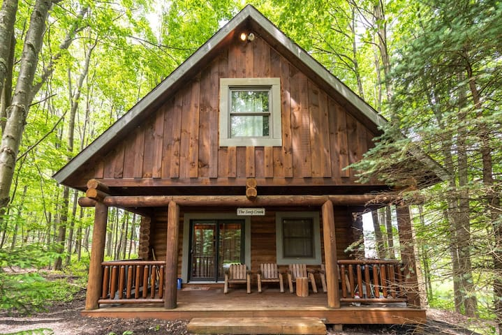 Lake Area Cabin w/Hot Tub, Wood Fireplace, & Charcoal Grill!