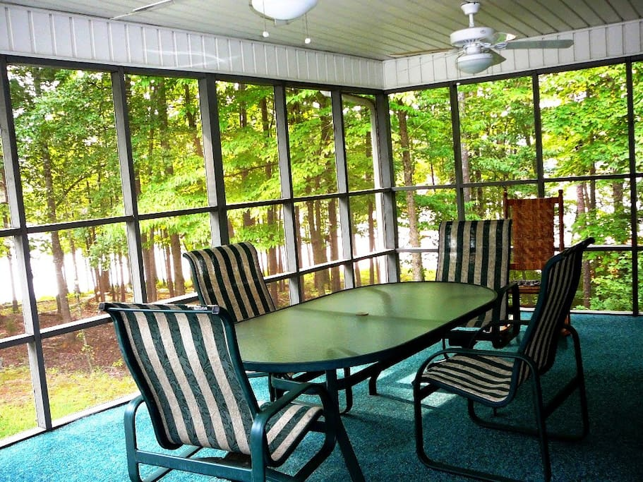 One of the two tables in screened porch overlooking the lake.