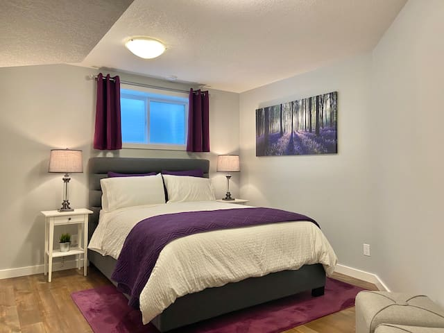 Queen size bed and frosted windows for privacy.
