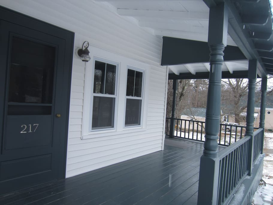 Front porch that wraps around to another entrance.  Spring is awaiting the 4 rockers and wrought iron couch