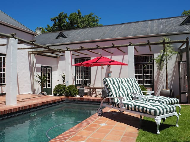 Solar heated swimming pool with relaxing Loungers.