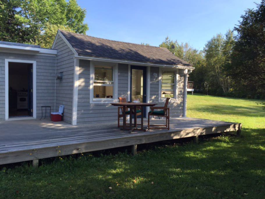 Cottage: Includes a deck for relaxing, outdoor furniture, and grill.