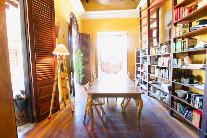 Grab a book from the 16' tall library and take the throne at the head of the dining room table surrounded by hanging plants and a fresh sea breeze.