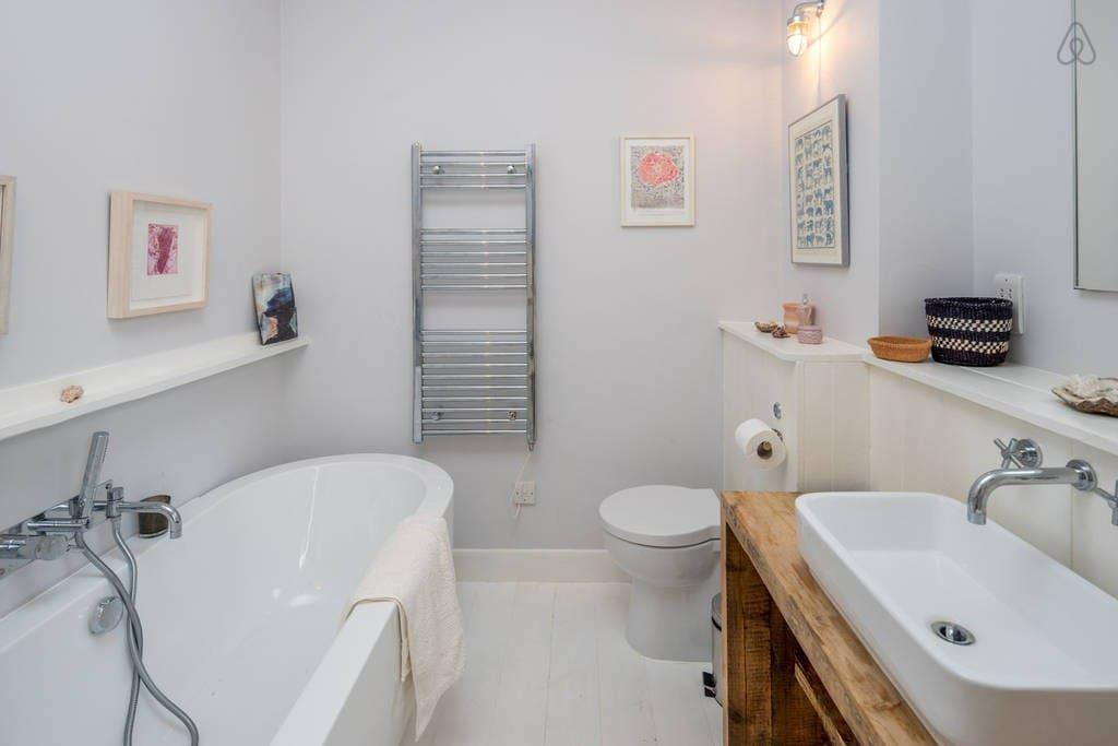 Bathroom 1 has a bath, sink and WC.
