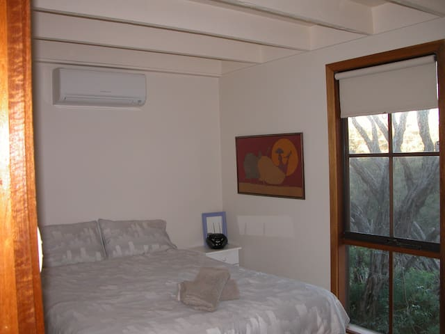 A view of the front  Queen size bedroom that overlooks the garden. The room has split level air conditioning and heating (just installed Jan 2016), plus CD/radio