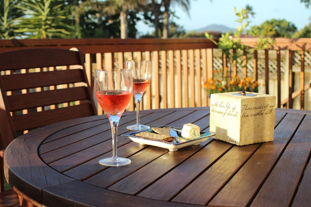 Enjoy the last of the sun from the back deck (that's iconic Rangitoto Island you can see in the distance)