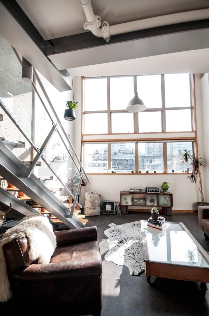 Bright corner suite loft.