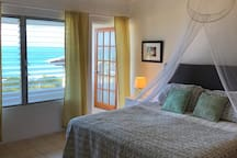 Your  beautiful, comfortable bedroom with a California King and a view of the Caribbean.