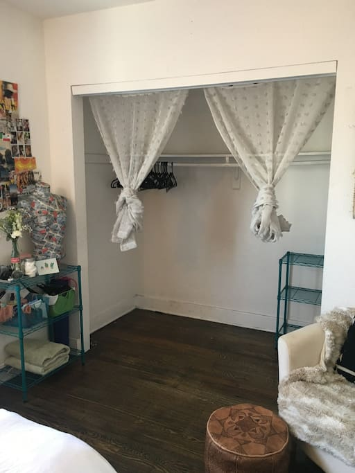 CLOSET WITH HANGERS AND STORAGE