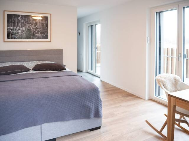 Master bedroom with direct deck, bathtub, shower, etc.