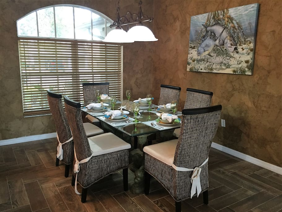 Formal dining room with seating for 6. Decorated in tropical theme.