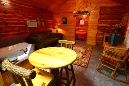 Cabin with Jacuzzi in the Ozark Mountains