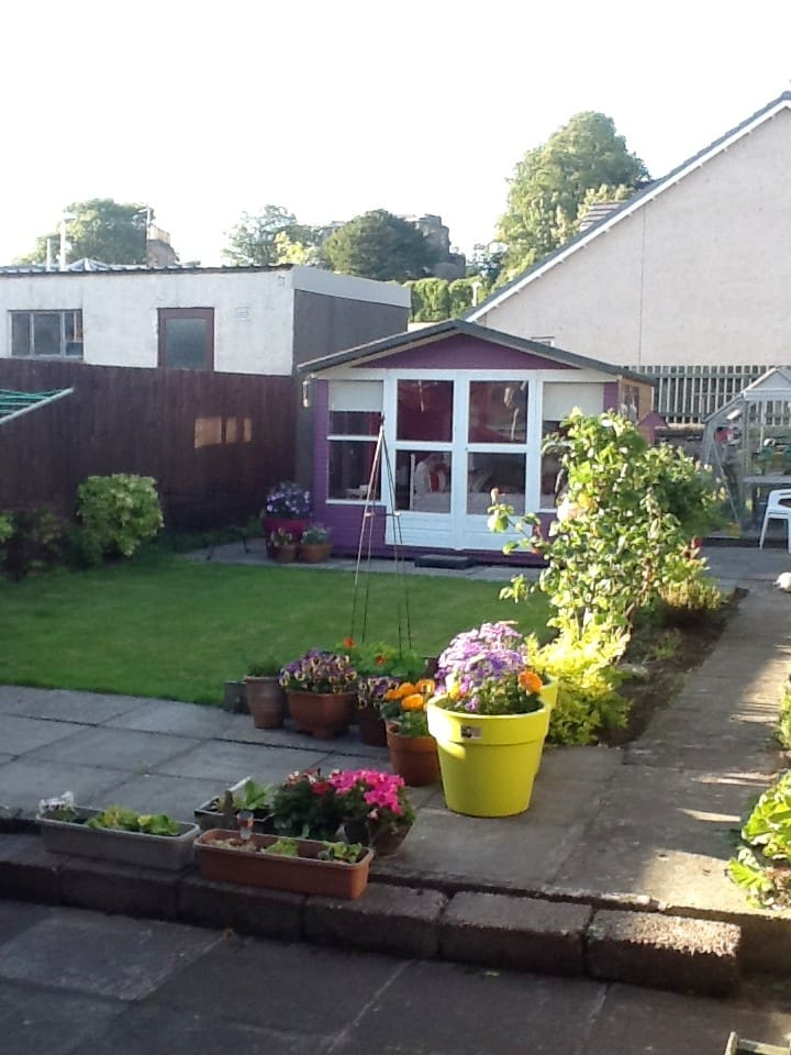 Private enclosed back garden with full access to lovely summerhouse!