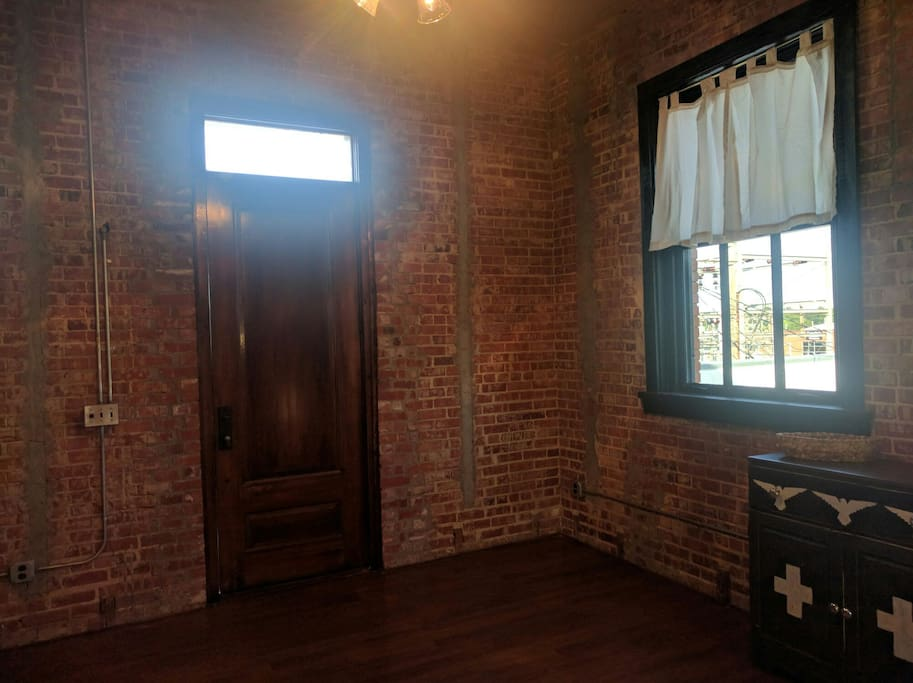 High ceilings, exposed brick and original historic windows.