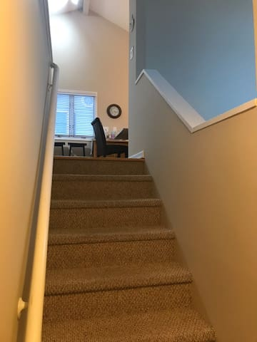 Stairs up to kitchen and living room