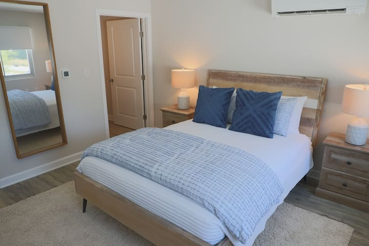Spacious bedroom with full length mirror