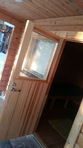 Sauna building with 2 persons double bed. The room also has a small fireplace and electric radiator.