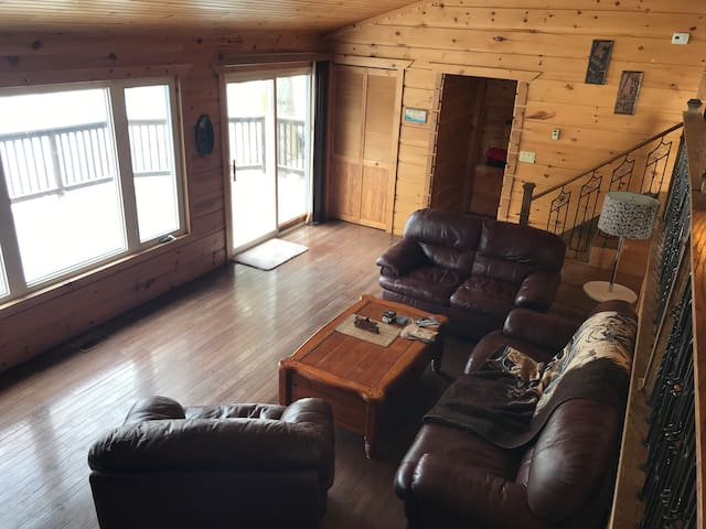 Main living room with access to deck overlooking the lake