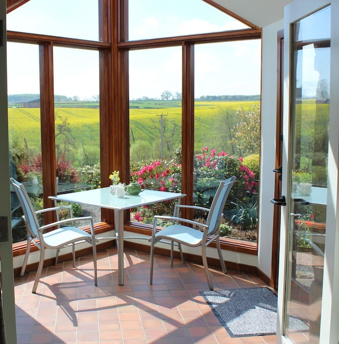 Relax in your south facing conservatory. Watch the birds enjoying your cottage garden.