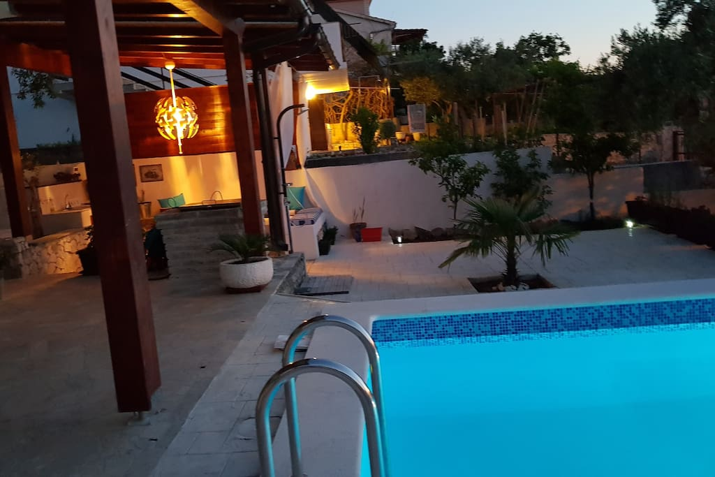 swimming pool, outdoor sitting area.