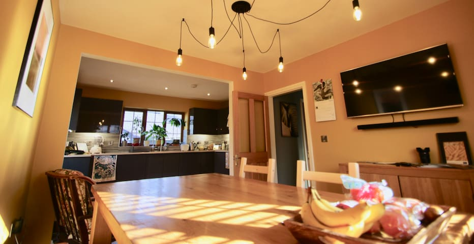 The shared open plan kitchen, dining room
