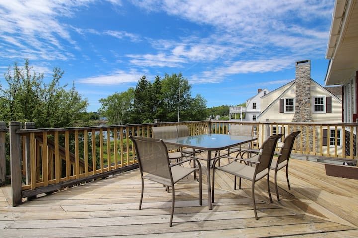 Charming water view home overlooking Mill Cove w/ a large deck - near town