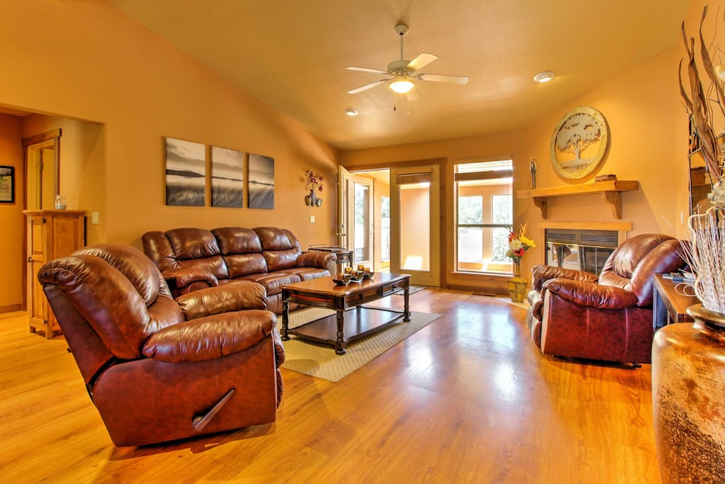 Honey hardwood floors and plush leather furniture welcome you inside the home.