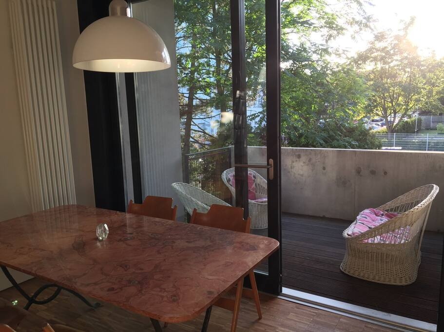 dining area with sliding door to front balcony