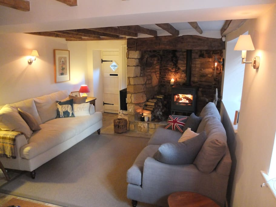 The ground floor is arranged as one large living space with a huge inglenook fireplace with woodburner.