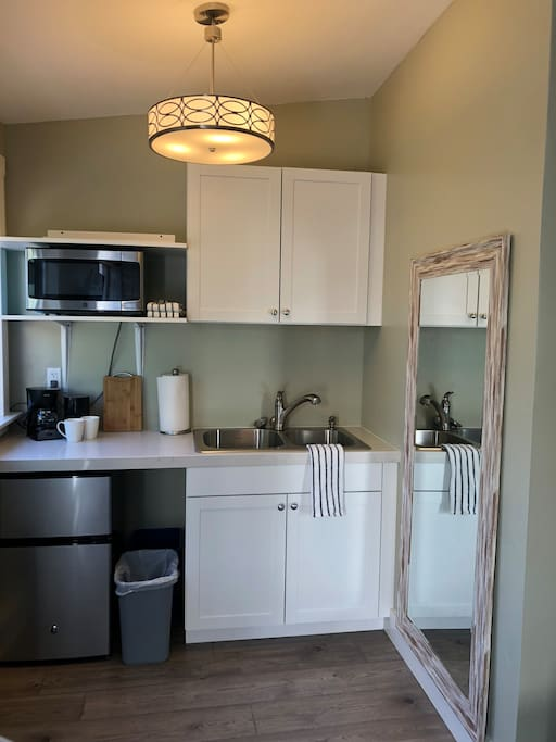 Kitchenette with microwave, coffee maker and mini fridge