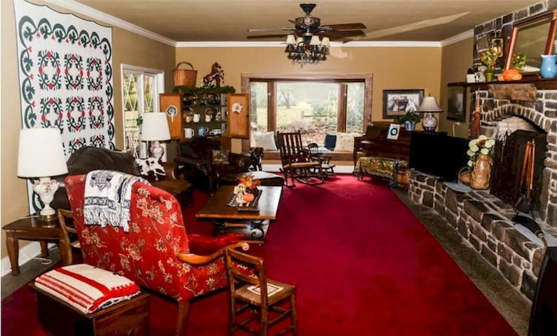 The living room is quite large and has a piano and we added a game table with chess, Scrabble, cards, etc.