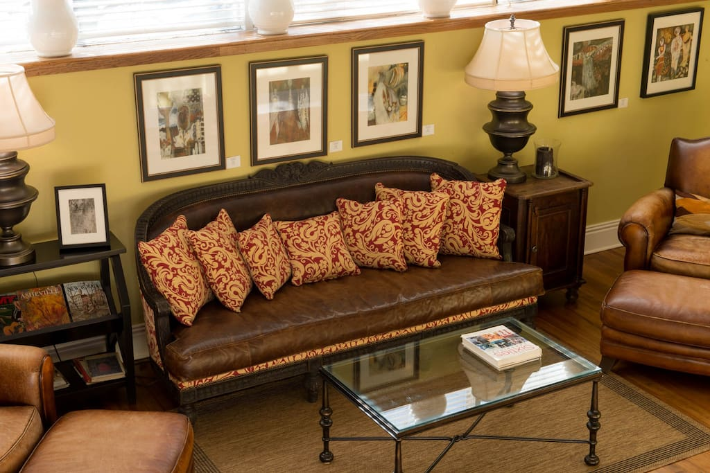 Sitting area with leather sofa & chairs