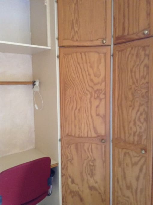 fitted wardrobe and desk area
