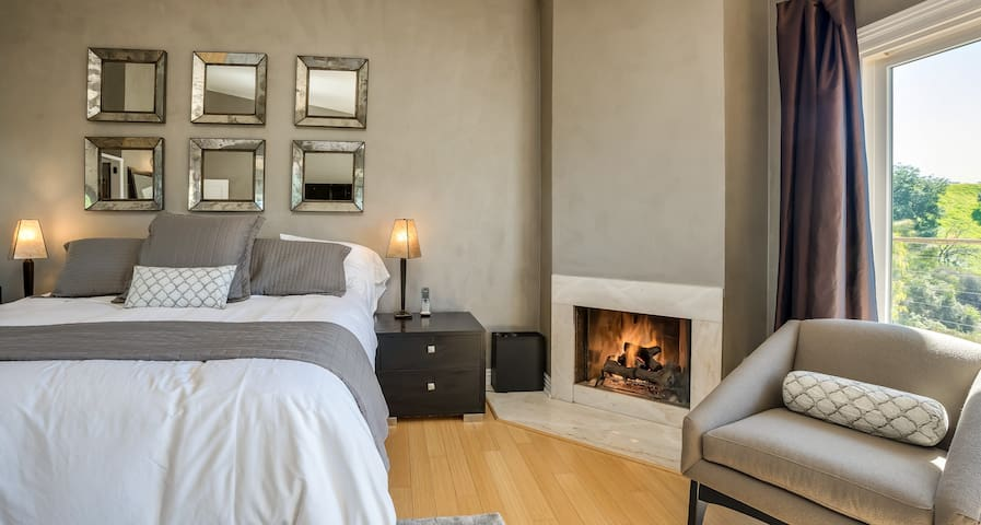 The master bedroom features a California King bed, fireplace, walk-in closet, balcony, desk/workspace, and much more!