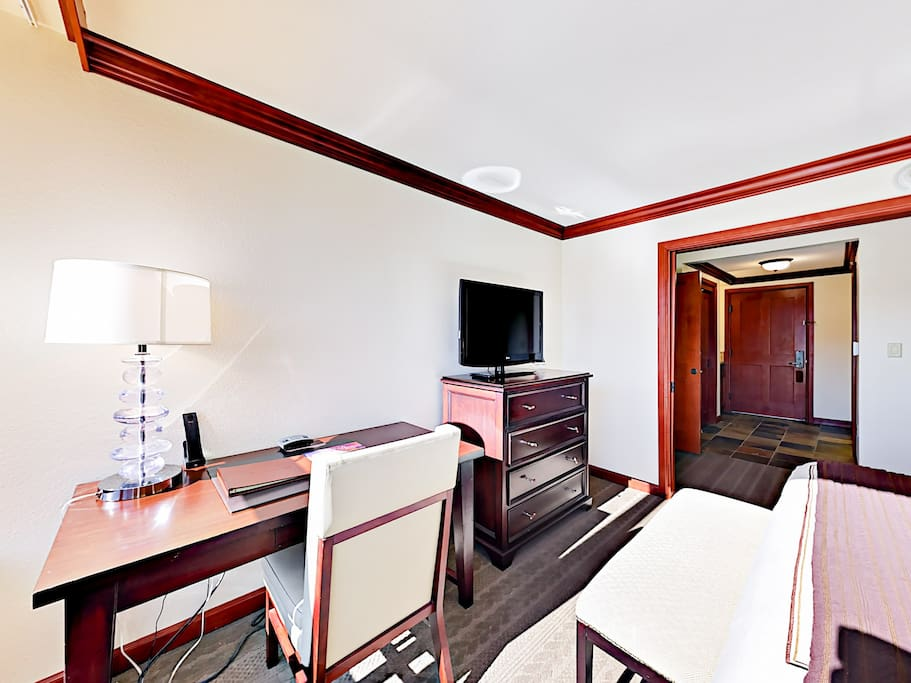Watch favorite shows on the flat screen TV and plan out daily activities at a convenient desk space.