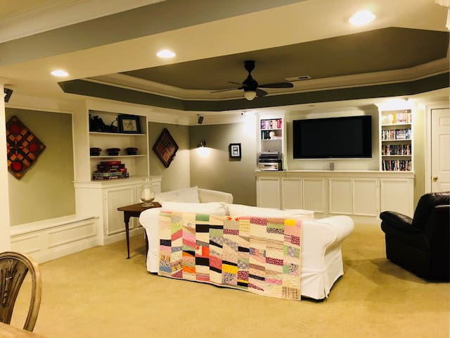 TV room with 55 inch TV, Amazon Prime streaming service (Hulu, Netflix, FilmStruck).