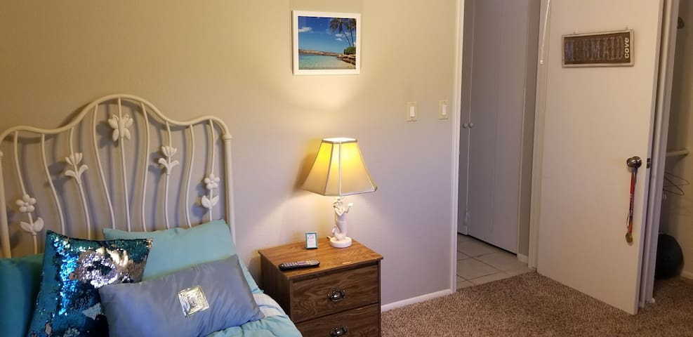 Room includes toiletries, nightstand, alarm clock and phone chargers for all types.